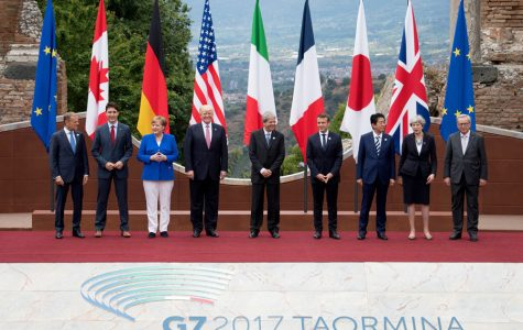 US President Donald Trump and Japanese Prime Minister Shinzo Abe pose for a photo with other world leaders at the 2017 G7 summit at Teatro Greco in Taormina, Sicily, Italy. On Friday, Northwestern professors discussed Japan's economic prospects as part of their fall lecture series.