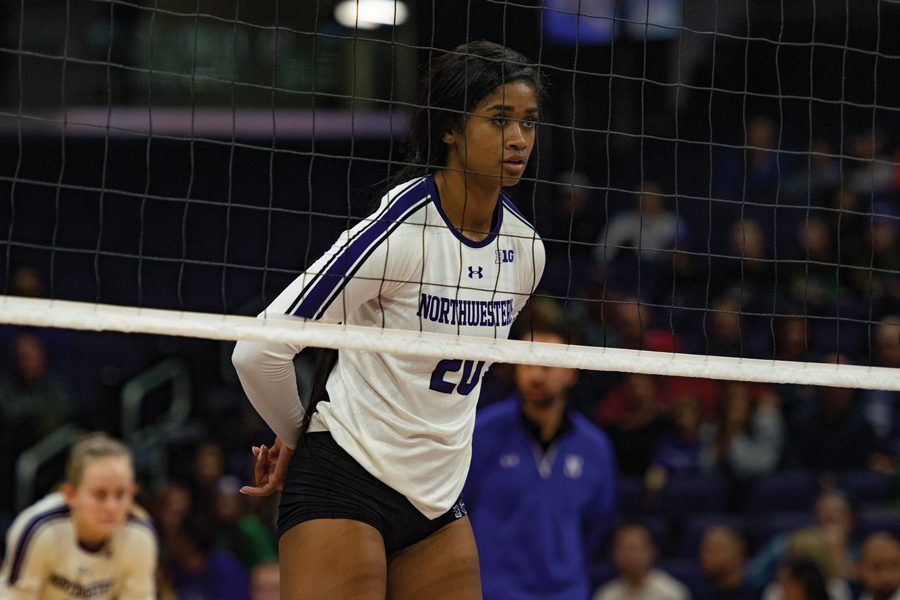 Alana Walker stands at the net. The junior middle hitter finished the game with 4.5 points.