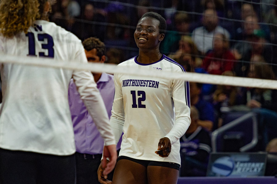 Temi Thomas-Ailara smiles after a point. Ailara leads the Big Ten with 4.47 kills/game.