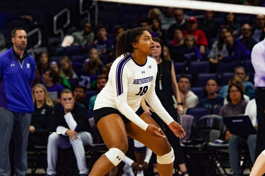 Nia+Robinson+waits+for+the+ball.+The+junior+outside+hitter+had+18+kills+Sunday%2C+but+the+Wildcats+still+fell+to+Rutgers.