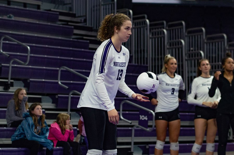 Olivia Viscuso prepares to serve the ball. The senior middle blocker is second on the team with eight service aces.