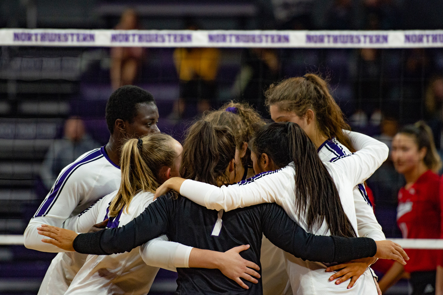 Northwestern gathers for a huddle. The Wildcats will try to pick up its first Big Ten win Saturday against Purdue.