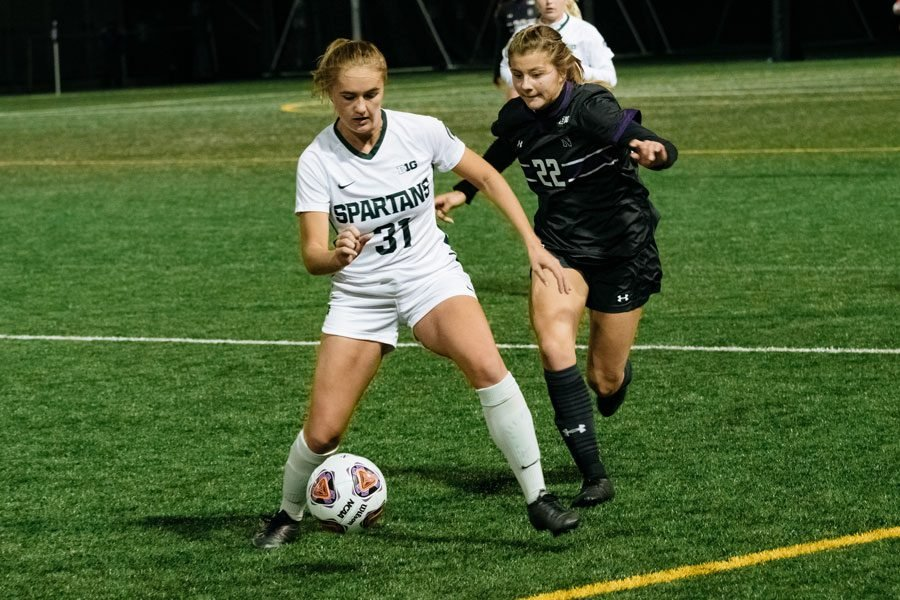 First year midfielder Lily Gilbertson attempts to steal the ball against Michigan State defender. Gilbertson's goal against the Spartans was the first of her Northwestern career.