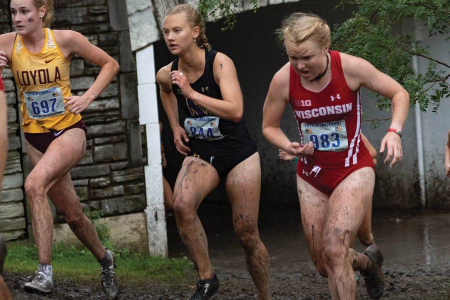 Amanda+Davis+runs+in+a+race.+The+junior+runner+participated+at+the+Loyola+Lakefront+Invite.+
