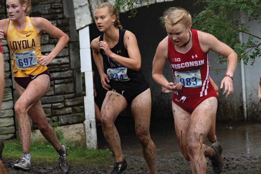 Amanda Davis runs in a race. The junior runner participated at the Loyola Lakefront Invite.