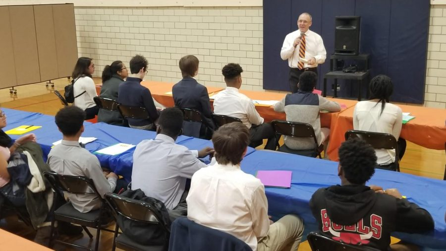 """Evanston mayor Steve Hagerty addresses participants at the 2018 Mayor's Summer Youth Employment Program job fair. The program connects """"at-risk"""" teenagers with employment opportunities and training."""