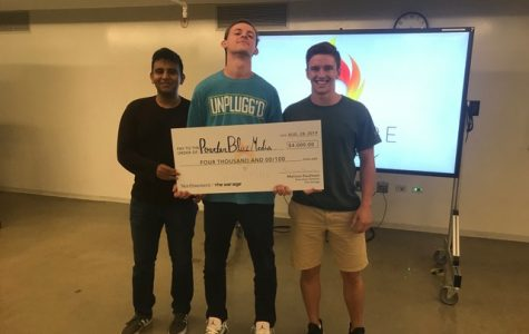 From left, Karim Noorani, Nathan Graber-Lipperman and Owen Guetschow pose with their $4,000 check in The Garage.