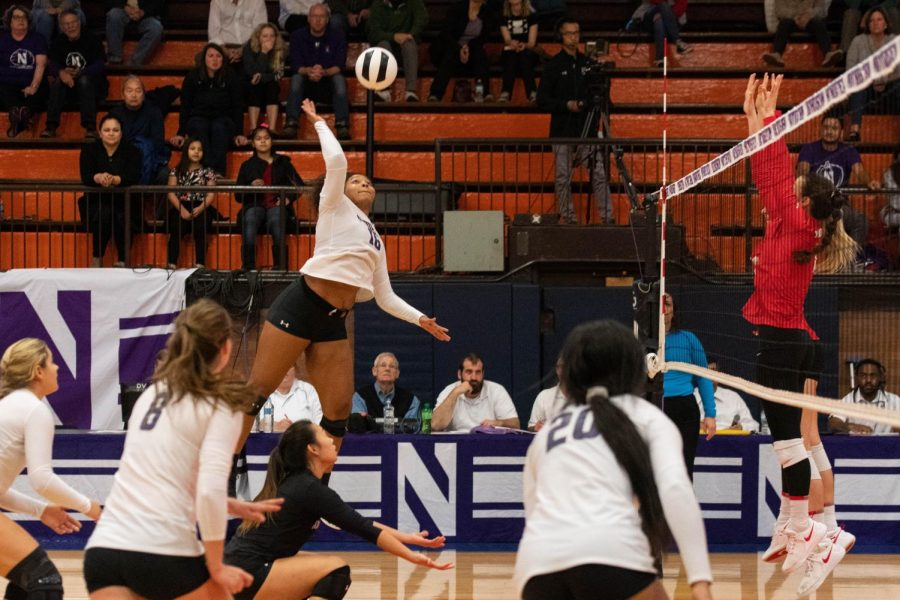 Nia+Robinson+hits+the+ball.+The+junior+outside+hitter+is+second+on+the+team+in+points.