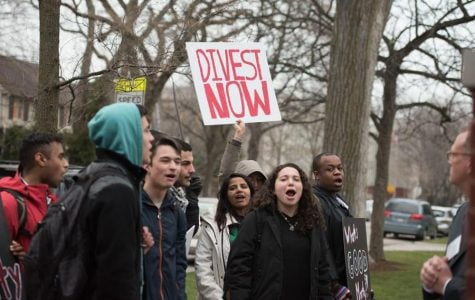 Student activists gather outside University President Morton Schapiro's house in April 2016. Northwestern's chapter of Students for Justice in Palestine is trying to build strong relationships with other activist groups on campus.