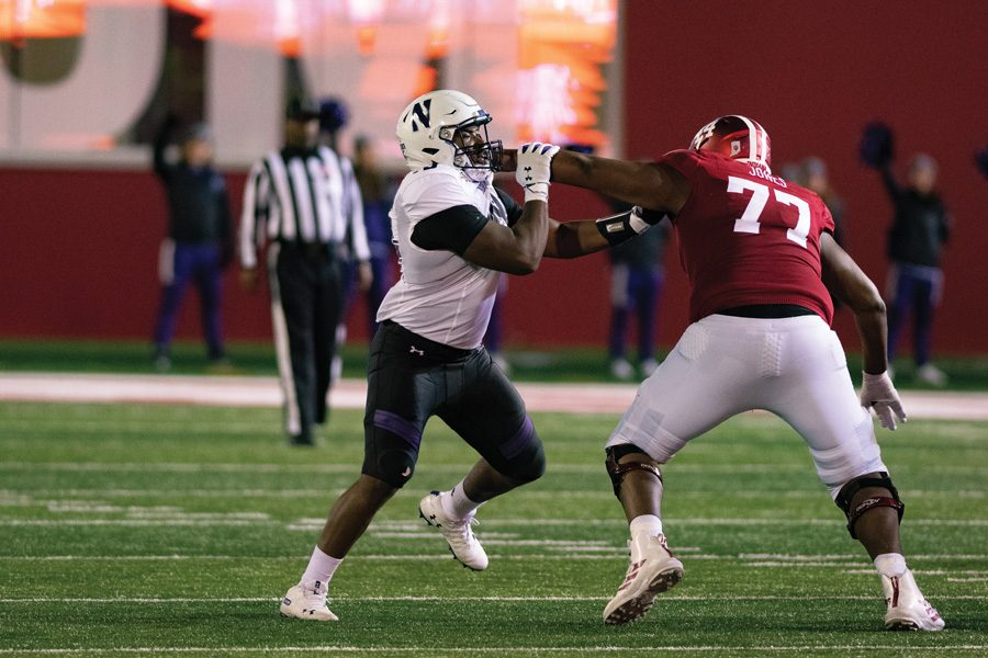 Adetomiwa Adebawore tries to get past a block. The freshman defensive lineman will make his first career start on Saturday.