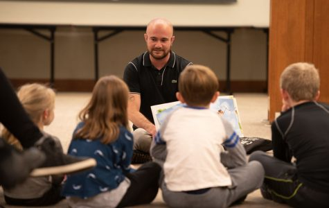"""Kyle Lukoff reads to children at Evanston Public Library. One of Lukoff's stories, """"When Aidan Became a Brother,"""" explores transgender identity and the feeling of having a new sibling."""