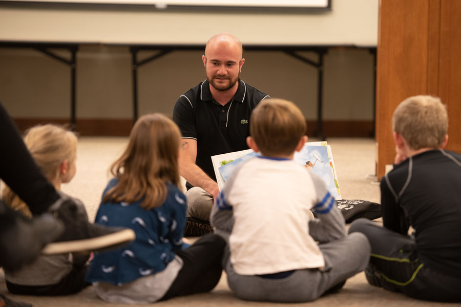 "Kyle Lukoff reads to children at Evanston Public Library. One of Lukoff's stories, ""When Aidan Became a Brother,"" explores transgender identity and the feeling of having a new sibling."