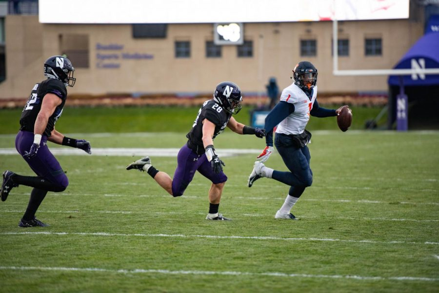 Chris Bergin chases down the quarterback. The junior linebacker plays alongside his brother Joe on NU's squad.