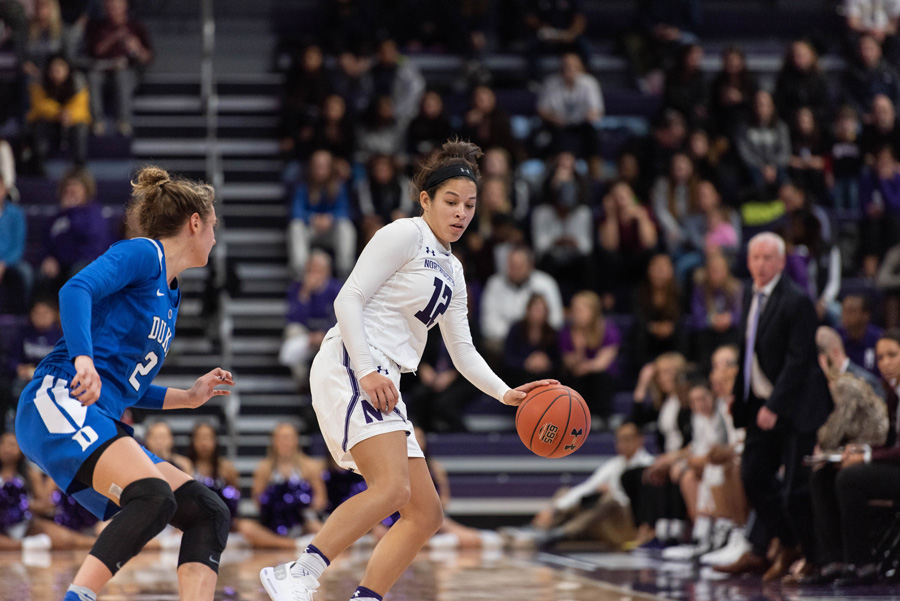 Veronica Burton fends off an oncoming defender. The sophomore guard could have a big impact on the team offensively this year.