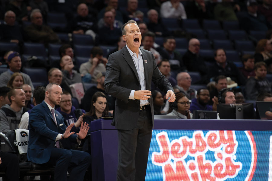 Chris Collins yells from the sideline. Northwestern has lost two of its first three games to start the season.