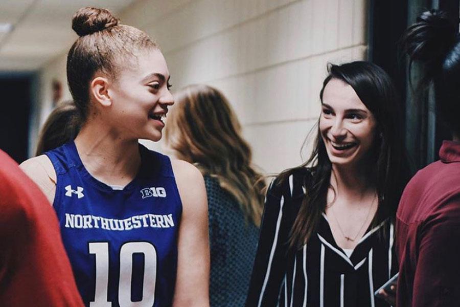 Hope Carpinello talks with junior guard Lindsey Pulliam. Carpinello traveled with Northwestern throughout the WNIT last season.