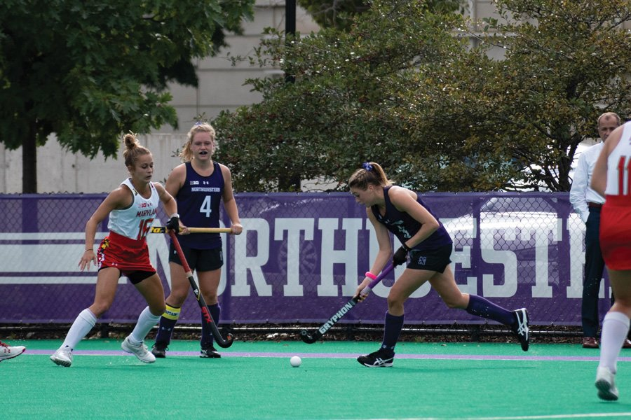Saar de Breij watches Shannon Daley hit the ball. The senior midfielder played her last regular season game for the Cats on Friday.
