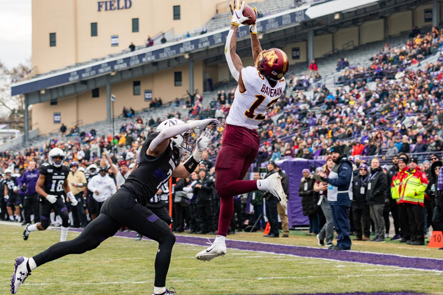 Rashod Bateman catches a ball in the end zone for a touchdown. The receiver had three touchdowns against Northwestern.