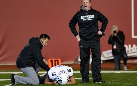 Coach Pat Fitzgerald yells after Hunter Johnson was injured in the third quarter. Johnson did not return to the game.