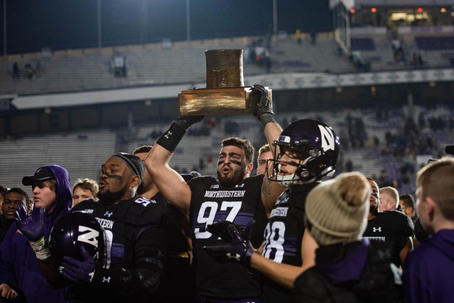 Joe Gaziano lifts the Hat trophy after Northwestern's 2018 win over Illinois. The senior has been one of NU's most productive players during his career in Evanston.