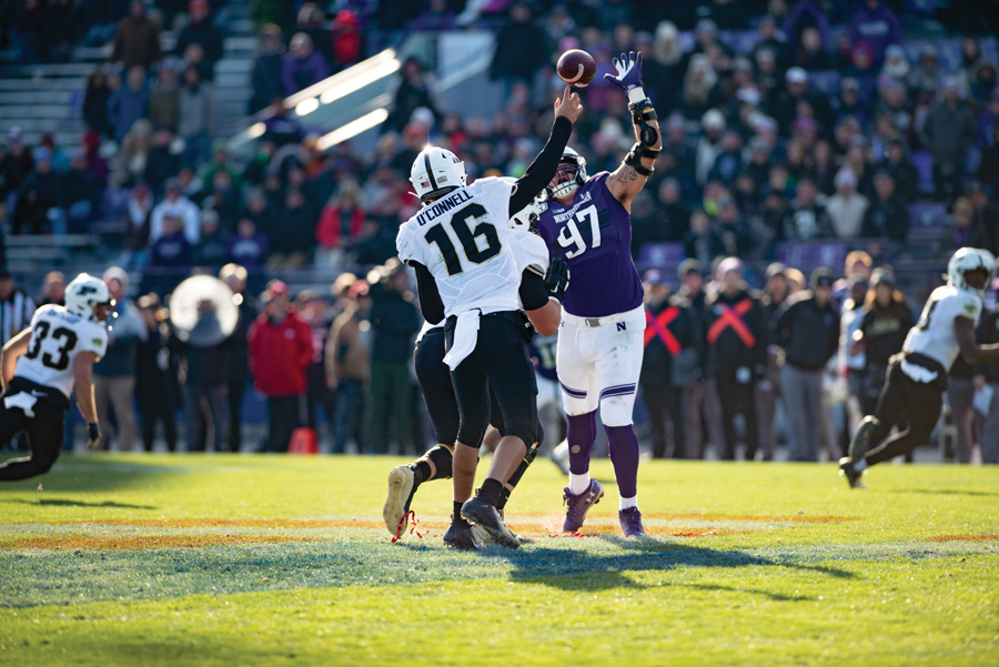 Joe Gaziano jumps to deflect a pass. The senior is within a half sack of the all-time Northwestern record.