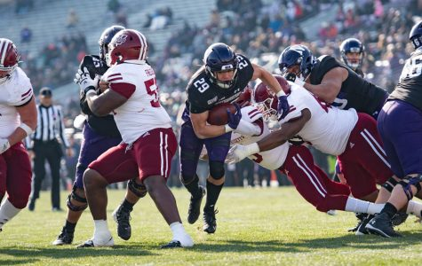 Evan Hull breaks through UMass tacklers on November 16. The redshirt freshman running back will likely see no more play this season.
