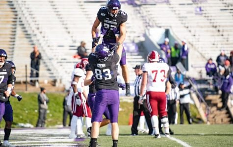 Trent Goens and Raymond Niro celebrate a Northwestern touchdown. The Wildcats beat UMass 45-6 on Saturday at Ryan Field.