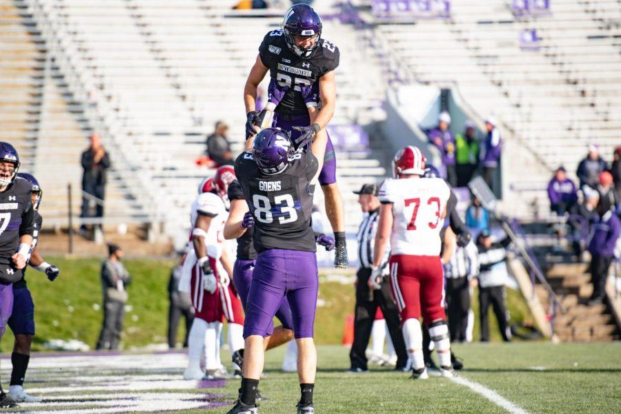Trent Goens and Raymond Niro celebrate a Northwestern touchdown. The Wildcats beat UMass 45-6 on Saturday at Ryan Field.