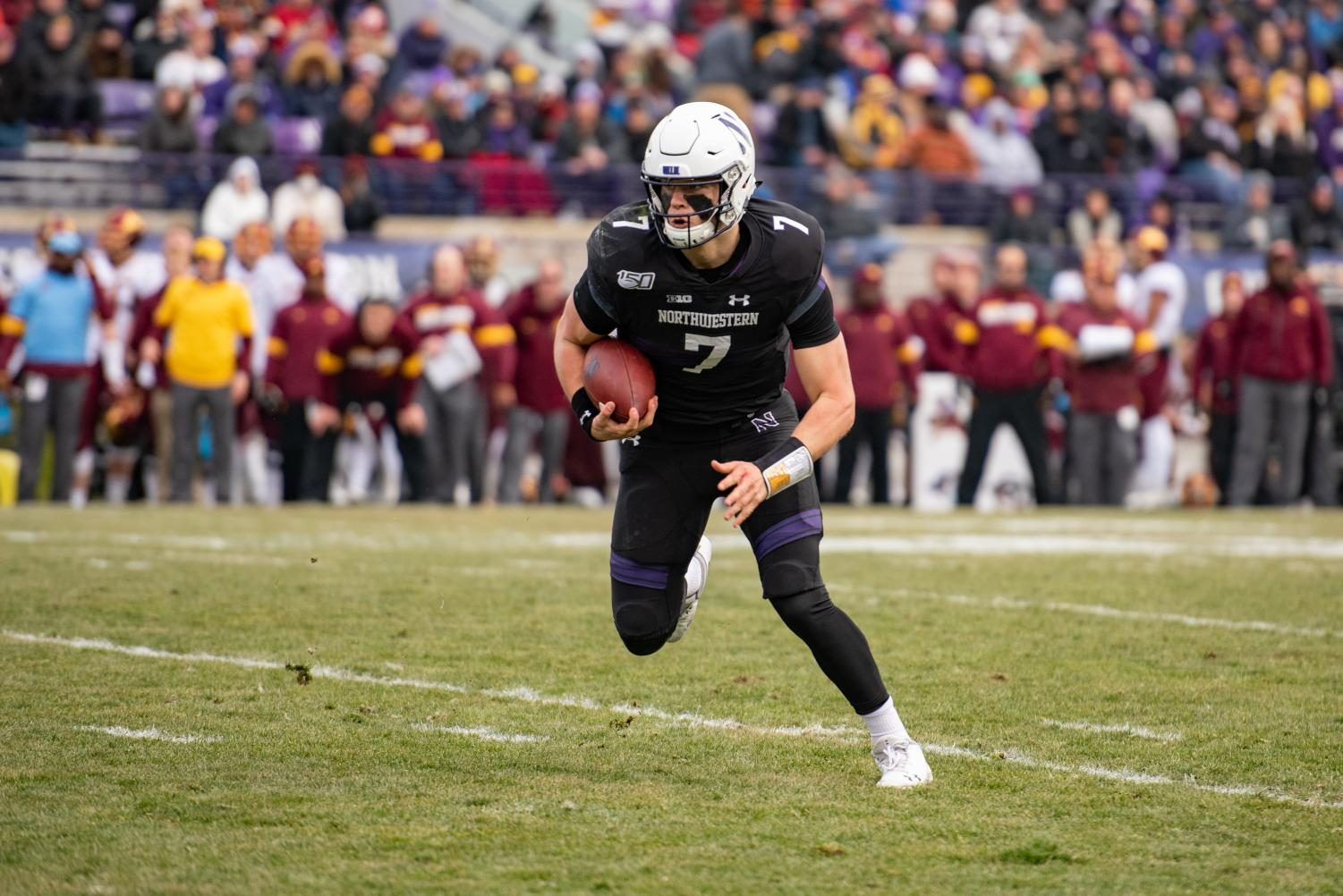 Andrew Marty carries the ball. The sophomore quarterback earned the first extended playing time of his career in Northwestern's 38-22 loss to Minnesota on Saturday at Ryan Field.