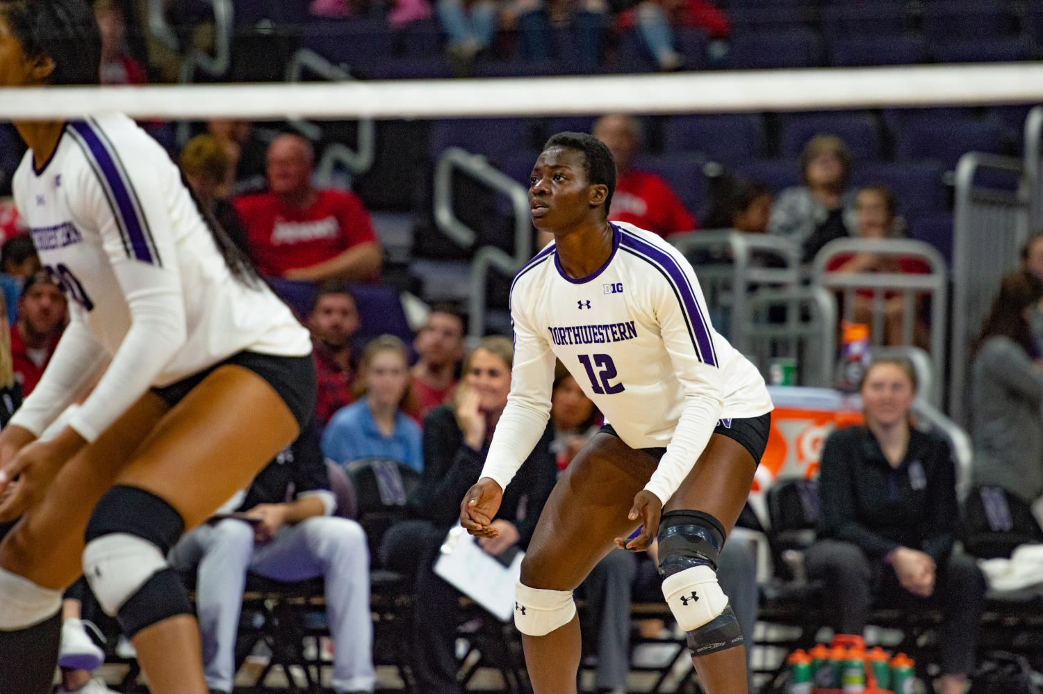 Temi Thomas-Ailara prepares to receive a serve. The freshman outside hitter returned after missing the last couple of games.