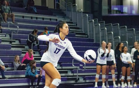 Peyton Chang prepares to serve the ball. The graduate server had service aces against Michigan State.