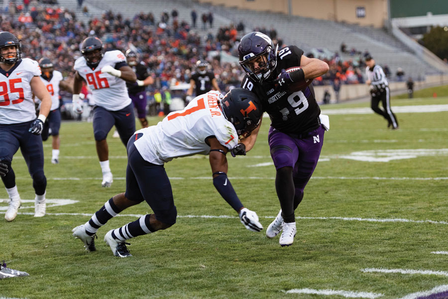 Riley Lees breaks a tackle during a 2018 game against Illinois. Northwestern will look for its fifth-straight win against the Fighting Illini this weekend.