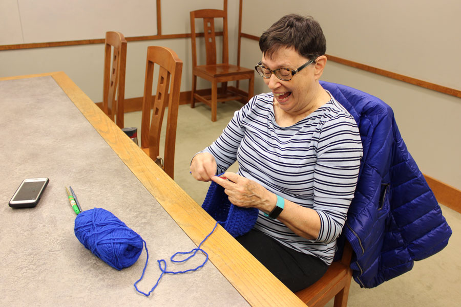 Evanston resident Sally Barnum crochets a winter hat for the emergency women's shelter at First United Methodist Church. Barnum founded the Evanston Public Library knitting circle about a year ago.