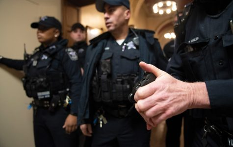 University police officers formed a shoulder-to-shoulder wall blocking the Lutkin Hall foyer amid protests against former Attorney General Jeff Sessions. An open letter signed by dozens of recent Northwestern graduates denounced Northwestern's choice to deploy UP officers to quiet student protestors.