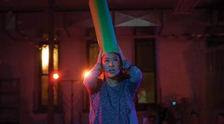Cast member Sarah Lo rehearses