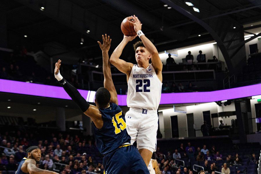 Pete+Nance+puts+up+a+shot.+The+sophomore+had+18+points+and+12+rebounds+in+the+Wildcats%E2%80%99+season-opening+loss+to+Merrimack+on+Friday.