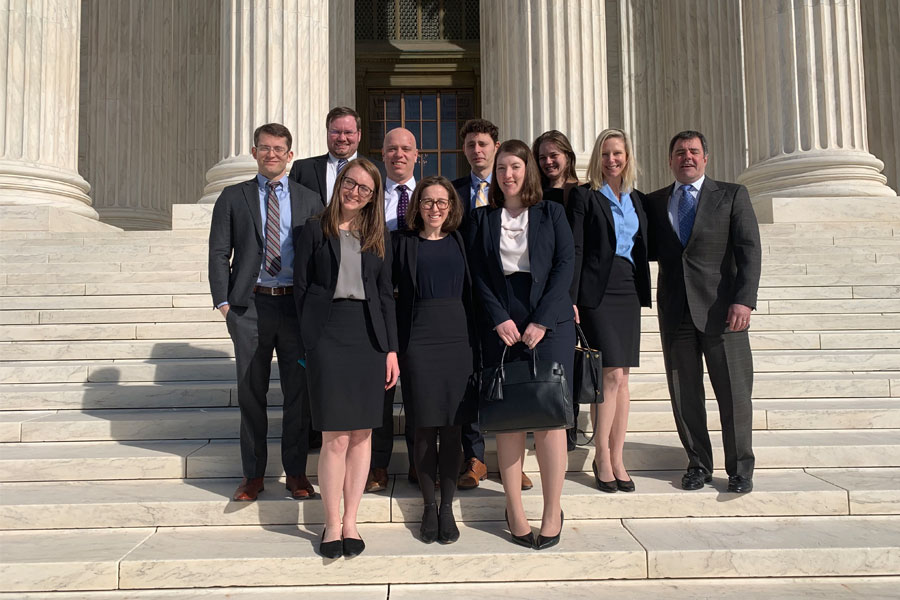 Prtizker+School+of+Law+students+and+faculty+and+representatives+from+Sidley+Austin+stand+on+the+steps+of+the+U.S.+Supreme+Court.+The+Appellate+Advocacy+Center+has+worked+on+about+250+cases+overall.