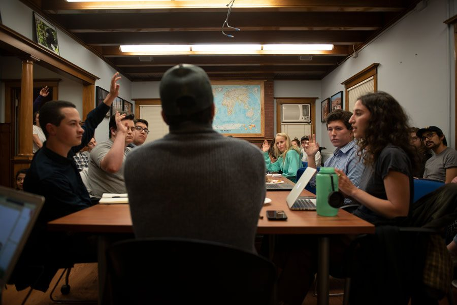 NUCR+vice+president+Dominic+Bayer+and+NU+College+Democrats+president+Romie+Drori+debate+across+the+table+at+a+discussion+hosted+by+Political+Union+on+Monday.+Over+50+students+joined+the+debate%2C+taking+stances+on+NUCR+fall+speaker+Jeff+Sessions.