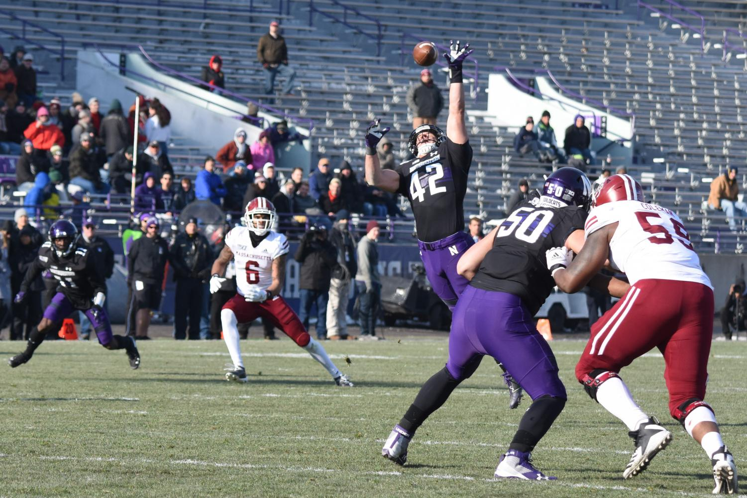 Paddy Fisher jumps for the ball. The junior linebacker and Northwestern beat UMass 45-6 on Saturday at Ryan Field.