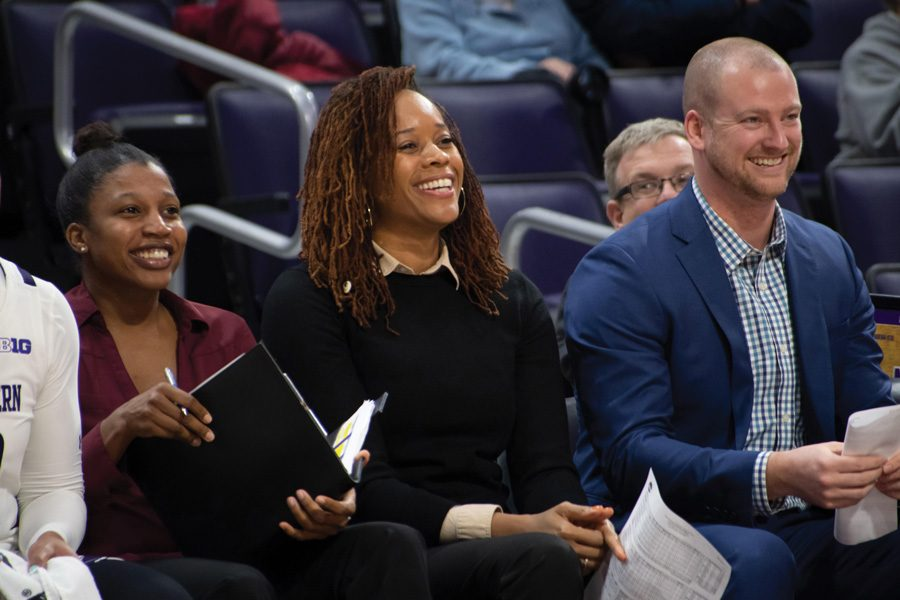 Tangela+Smith+smiles+on+the+sidelines.+Smith+is+in+her+second+year+as+an+assistant+coach+at+Northwestern.