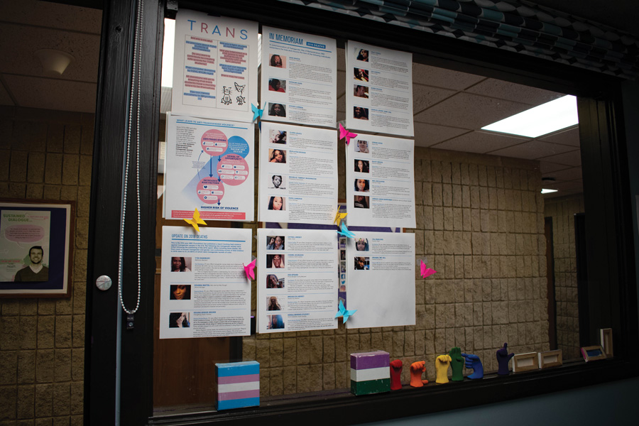 The windows of the Gender and Sexuality Resource Center displays the faces of 22 transgender individuals lost to transphobic violence in 2019. A small group gathered at Norris University Center for Transgender Day of Remembrance.