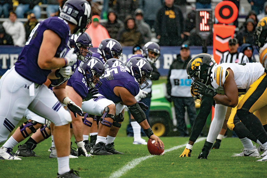 Northwestern's offensive line readies for a play. Both NU and UMass — this week's opponent — have struggled this season.