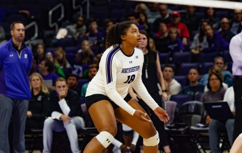 Nia Robinson prepares to receive a serve. She led the Cats with 12 kills on Saturday.