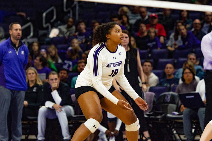 Nia+Robinson+watches+the+ball.+The+junior+outside+hitter+was+honored+for+recording+her+1%2C000th+kill+against+Michigan+State.