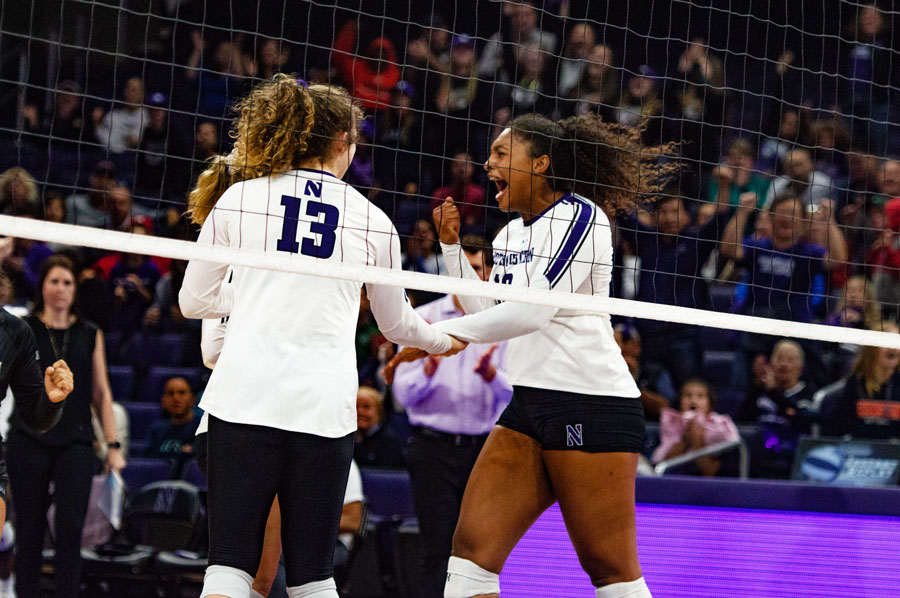Olivia Viscuso and Nia Robinson high-five. The Wildcats won a pair of road matches against Ohio State and Maryland this weekend.
