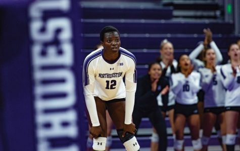 Temi-Thomas Ailara stares at her opponent. The freshman outside hitter will have a big impact on Friday's game after not playing in the team's first game against Rutgers.