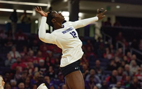 Outside hitter Temi Thomas-Ailara prepares to spike the ball. The freshman averages the second most kills in the conference at 4.07.