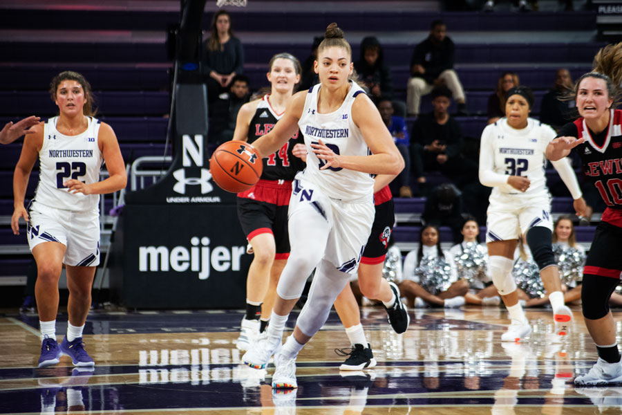 Lindsey Pulliam drives to the basket. The junior guard scored 26 points in the Wildcats' win at Duke on Sunday.