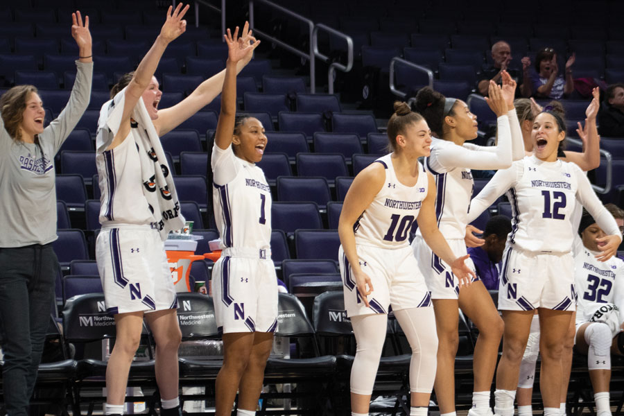 The Wildcats bench celebrates. NU is off to a 3-0 start for the second straight season.
