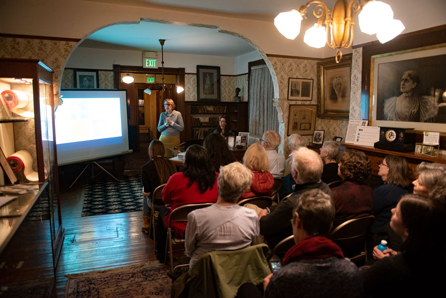 "Lori Osborne, the Frances Willard House Museum director, speaks to a crowded room Thursday. She introduced the digital exhibit ""Truth Telling: Frances Willard and Ida B. Wells,"" which reflects on the conflict between the two historical figures."